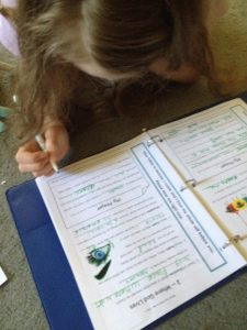 girl working on Bible and Prayer Curriculum